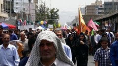 Crowd of Iranian demonstrators rally in street against Israel during Quds day Stock Footage