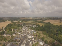 France Europe small town in a cloudy day aerial Stock Footage
