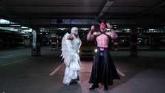 Young man in disguise of the devil Halloween dancing with freaky girl in the Arkistovideo