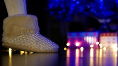 Girl in funny socks quietly sneaks past the Christmas tree to gifts at night Stock Footage