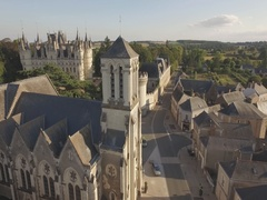 France Europe small town churce rotating around cloudy day aerial Stock Footage