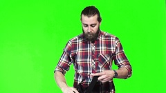 Bearded man play or watch video in VR Stock Footage