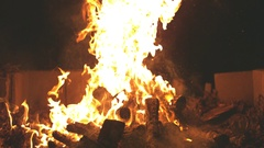 Black Powder Exploding in Burning Campfire in Slow Motion Stock Footage