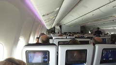 Passengers In Flight On A Boeing 777 Airliner Jet Aircraft Stock Footage