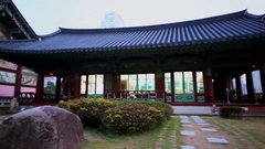 People stand near edifice of Bongeunsa temple at autumn Stock Footage
