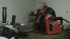 Electric saw close up, craftsman working in the background by Sheyno. Stock Footage