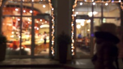 Blurred windows of coffee house with glowing lights. Arkistovideo