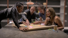 A group of business millennials working together in a co-working space Stock Footage