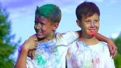 Portrait of two boys holding each other on the shoulders smiles in delight after Stock Footage