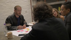 A creative team of entrepreneurs collaborating together at a table Stock Footage