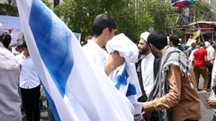 Iranian basij carrying flag of USA Israel during Quds day to burn them later on Stock Footage