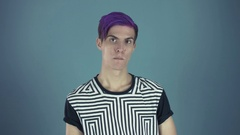 Young pleased blogger with purple hair looking at camera and dancing in web Stock Footage