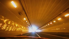 Traveling by one way road in tunnel with illumination Stock Footage