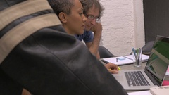 An African American woman leads a business meeting with her millennial team Stock Footage