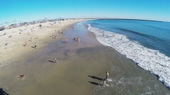 Wide Shot Looking South On Beach From Pier- Seal Beach CA- 4K Stock Footage