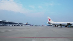 Many planes are on airdrome near edifice of Pudong airport Stock Footage