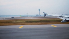 Airplane takes off from airfield at autumn morning. Aerial view Stock Footage