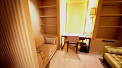 Panorama of cabinet with table and chairs in apartments of IFC Residence hotel Stock Footage