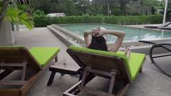 Two-year-old girl near hotel pool Stock Footage
