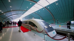 People walk near Maglev train on station in Shanghai Stock Footage