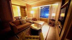 Light turns off and on at sitting room in apartments of IFC Residence hotel Stock Footage