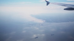 Airplane flight above sea water with vessels not far from shore Stock Footage