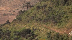 CLOSE UP: Safari jeep game driving and descending into Ngorongoro volcano crater Stock Footage