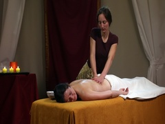 Beautiful oil back massage in candle light Stock Footage