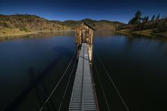 Heenan Reservoir with damn gate building at night with stars. Lit by moonligh Stock Photos