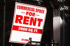 Close up of rental sign outside commercial building Stock Photos