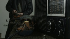 Repairman working and listening radio at the workshop, tilt up by Sheyno. Stock Footage