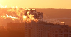 Smoke from pipes in high-rise residential building, early morning, backlight. Stock Footage