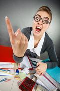 Angry furious young blonde businesswoman. Stock Photos