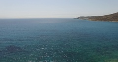 Flight over the beaches of Greek island of Ios Cyclades, Greece. Stock Footage