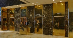 Interior Establishing Shot of Elevator Banks Inside Lobby of Trump Tower  	 Stock Footage