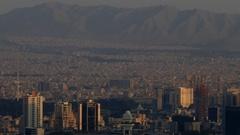 Cityscape of Tehran capital of Islamic republic of Iran sun light over buildings Stock Footage