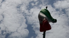Flag of Islamic republic of Iran waving in wind blue sky & clouds in background Stock Footage