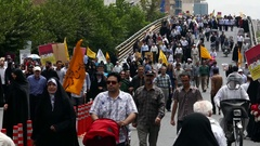 Crowd of Iranian demonstrators rally on a bridge against Israel during Quds day Stock Footage