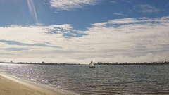 Wide Shot Distant Sailboat On Mission Bay- San Diego CA Stock Footage