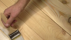 Wooden boards staining white. Board painting. Stock Footage
