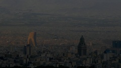 Ray of early morning sun light on top of buildings of Tehran the capital of Iran Stock Footage