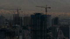 Skyscrapers construction, ray of sun light on top of buildings of Tehran Iran Stock Footage