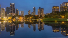 Building reflection surrounding KLCC park Stock Footage