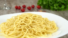 Delisious fresh homemade pasta rotating on a white plate. Seamless loopable Stock Footage