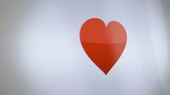 Digital Heart Avatar on Phone Screen close up Stock Footage