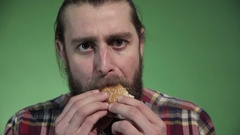 Middle shot of man eating burger Stock Footage