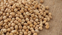 Raw chickpeas on a burlap rotating. Seamless loopable. Prores 4K Stock Footage