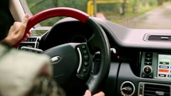 Inside Car Hand on Steering-wheel Dashboard Window under Rain Stock Footage