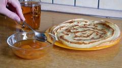 Pancakes with apricot jam Stock Footage