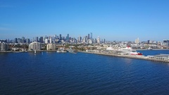 Orbit shot of pier in Port Melbourne and view of skyline in CBD Stock Footage